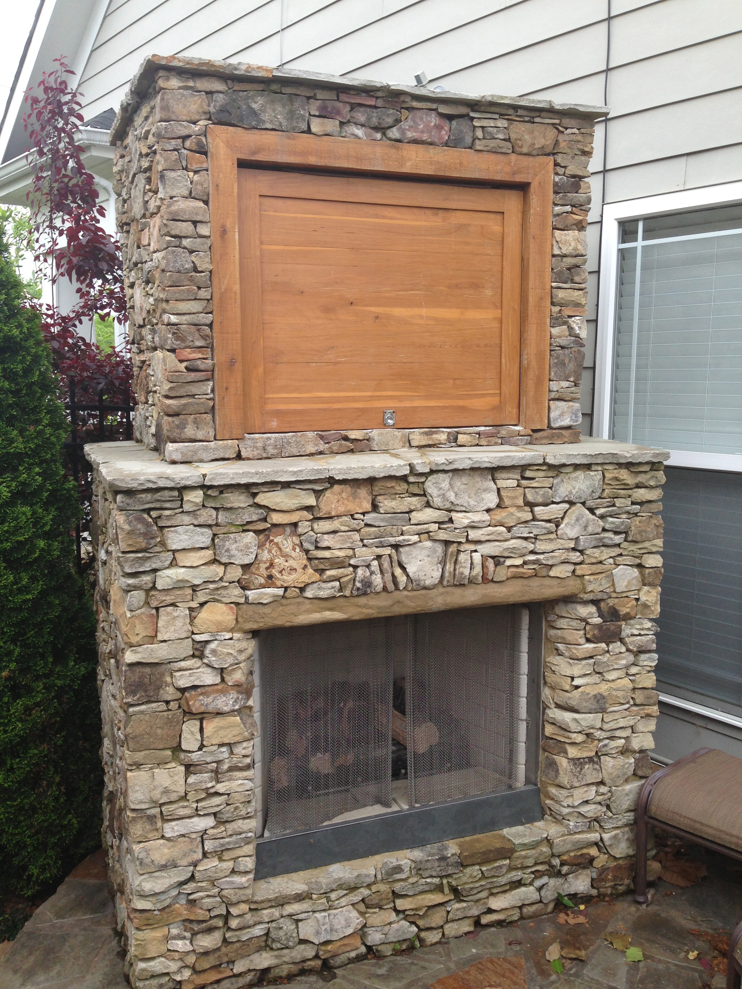 outdoor pool patio steps fireplace grill and landscaping